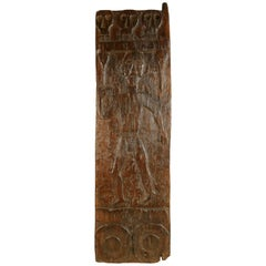 African Wooden Granary Door with Carved Motifs and Sculls
