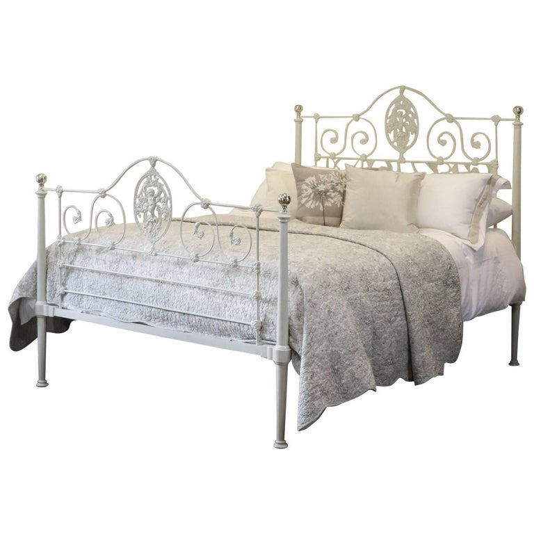 fine cast iron bed with cherub decoration mk120 for sale at