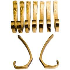 Nine Austrian Brass Wall Hooks by Hertha Baller in the Carl Auböck Style