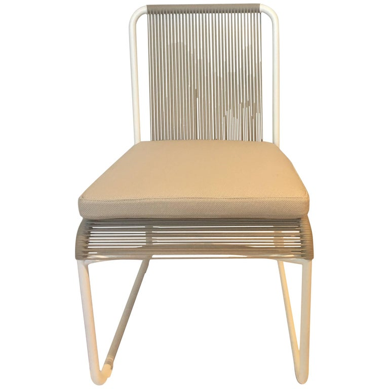 Outdoor Dining Chair by RODA in Milk and Sand Color with Ivory Seat Cushion