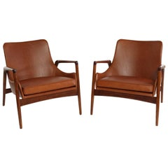 Pair of Ib Kofod Larsen Leather and Oak Lounge Chairs