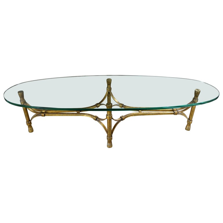 hollywood regency midcentury gilt iron base coffee table with elliptical glass for sale at 1stdibs. Black Bedroom Furniture Sets. Home Design Ideas