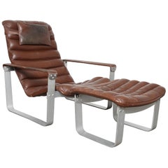 Leather Adjustable Metal Framed Lounge Chair and Ottoman by Ilmari Lappalainen