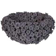 Marigold Bowl, a floral black stoneware ceramic centrepiece by Vanessa Hogge