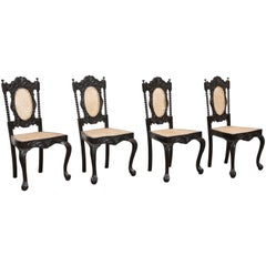 Four Mid-19th Century Exquisitely Carved Solid Ebony and Cane Side Chairs