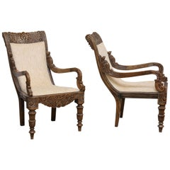 Pair of 19th Century Solid Satinwood Intricately Carved Plantation Chairs