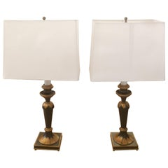 Pair of Ebonized and Gold Table Lamps