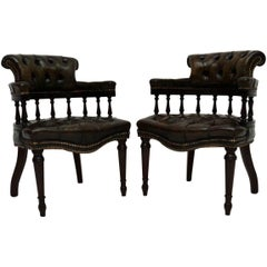 Pair of Distressed Leather and Mahogany Armchairs