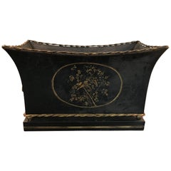 1970s Black and Gold Tole Cachepot with Floral Motif and Lion Head Handles