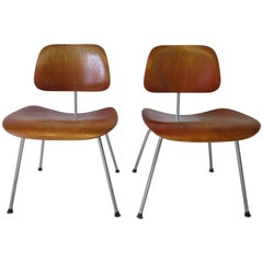 Eames Red Aniline Dyed DCM Chairs by Herman Miller