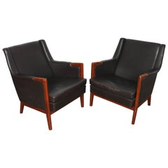 Pair of Black Leather Lounge Chairs by Karl Erik Ekselius of Sweden