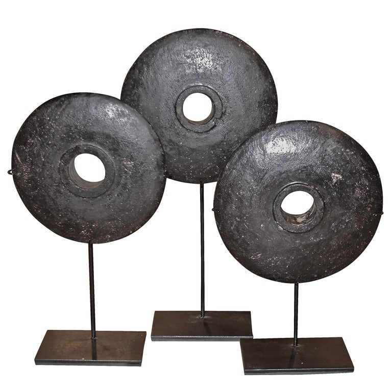 Set of Three Black Stone Coins on Stands, Indonesia, Contemporary