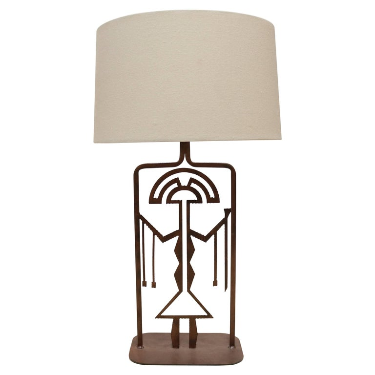 Rust Finished Metal Lamp with Symbolic Figure For Sale