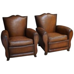 Pair of French Cognac Moustache Back Leather Club Chairs, 1940s