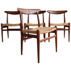 "Set of Four Hans Wegner ""W2"" Teak and Cane Dining Chairs"