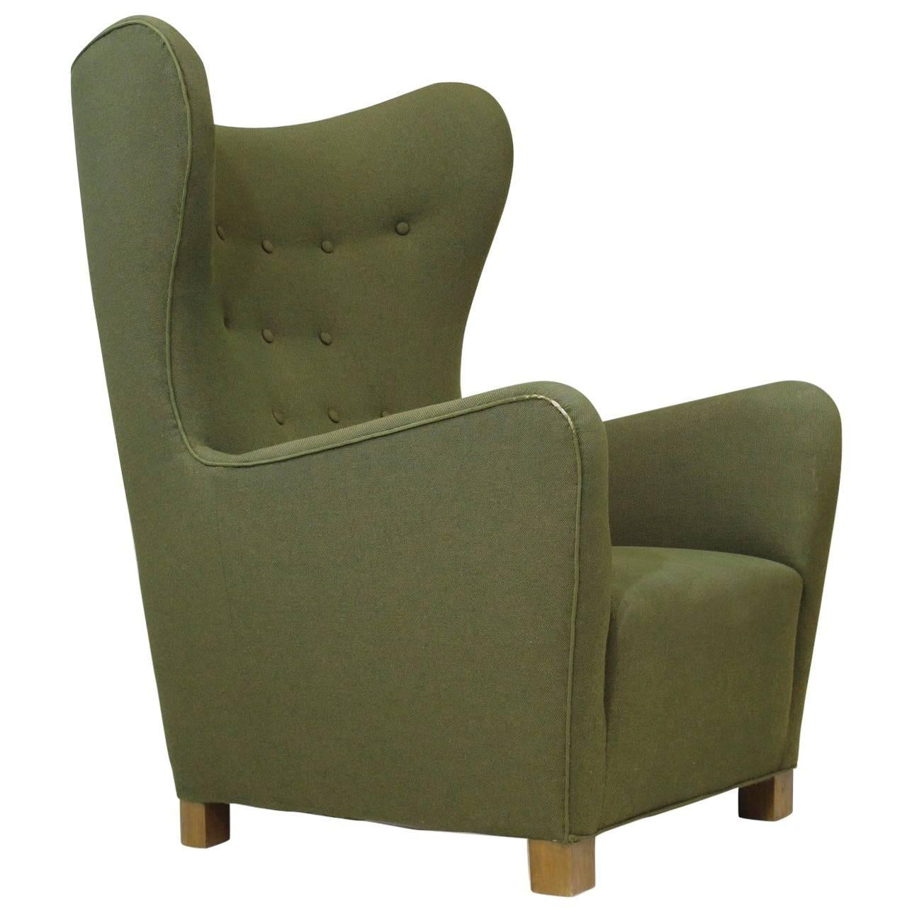 fritz hansen model wing back chair in the original green wool fabric