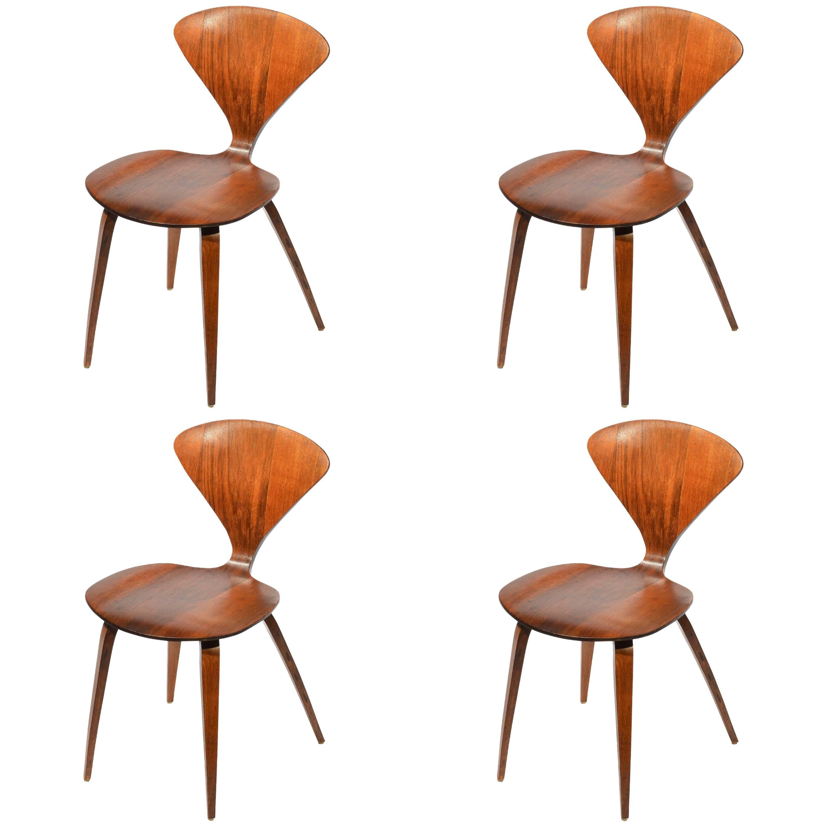 set of four early norman cherner dining chairs in walnut for plycraft