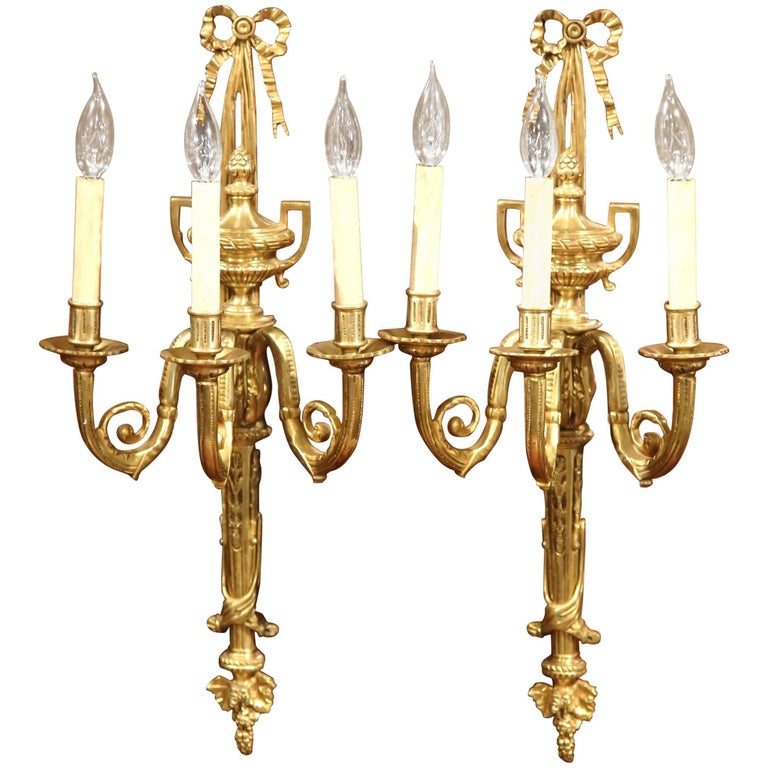 Pair of Early 20th Century French Louis XVI Three-Light Bronze Wall Sconces