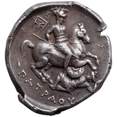 Ancient Greek Silver Tetradrachm Coin with a Warrior on Horseback, 335 BC