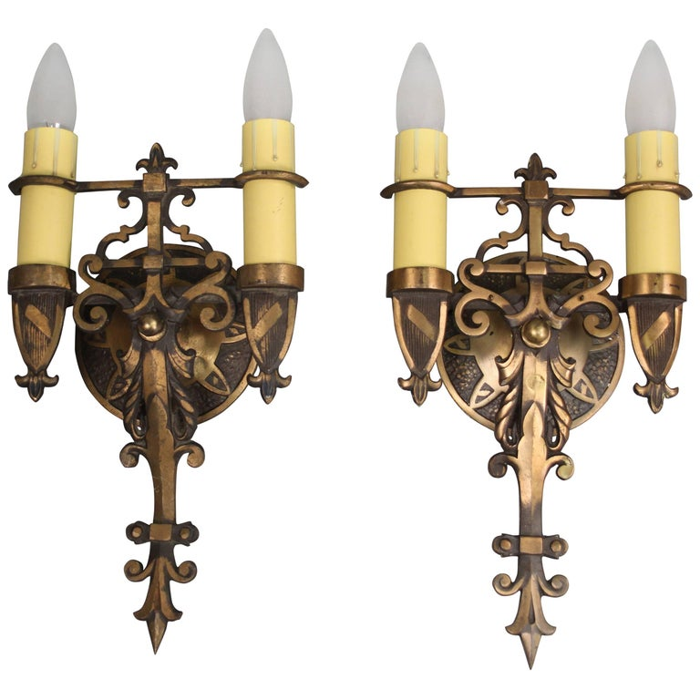 Pair of Antique Spanish Revival Brass Sconces circa 1920s with Shield Motif