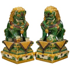 Pair of Oversize Chinese Sancai Glazed Foo Dogs on Pedestals