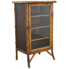 Antique English Bamboo Cabinet with Pressed Leather