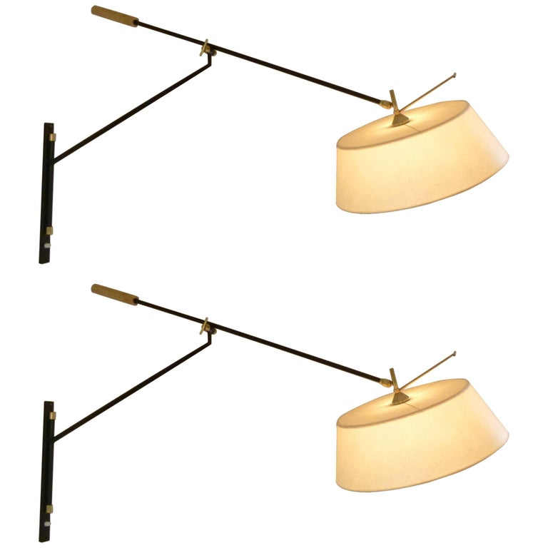 Pair of 1950s Large Suspended Sconces Mounted on Patella by Maison Lunel For Sale