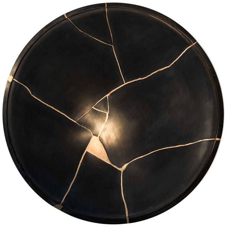 Kintsugi Sound Mirror-a focal wall mounted cast sculpture that alters sound