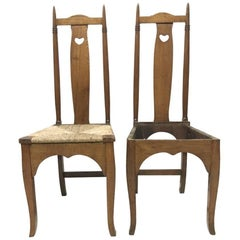 Shapland & Petter a Pair of Arts & Crafts Oak Dining Chairs with Pierced Hearts