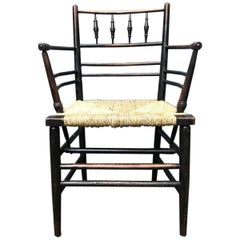William Morris, Five Classic Arts & Crafts Ebonised Rush Seat Sussex Armchairs