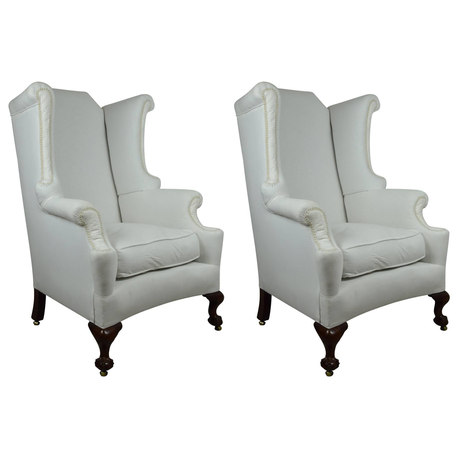 pair of antique georgian style wingback chairs with mahogany claw and ball feet