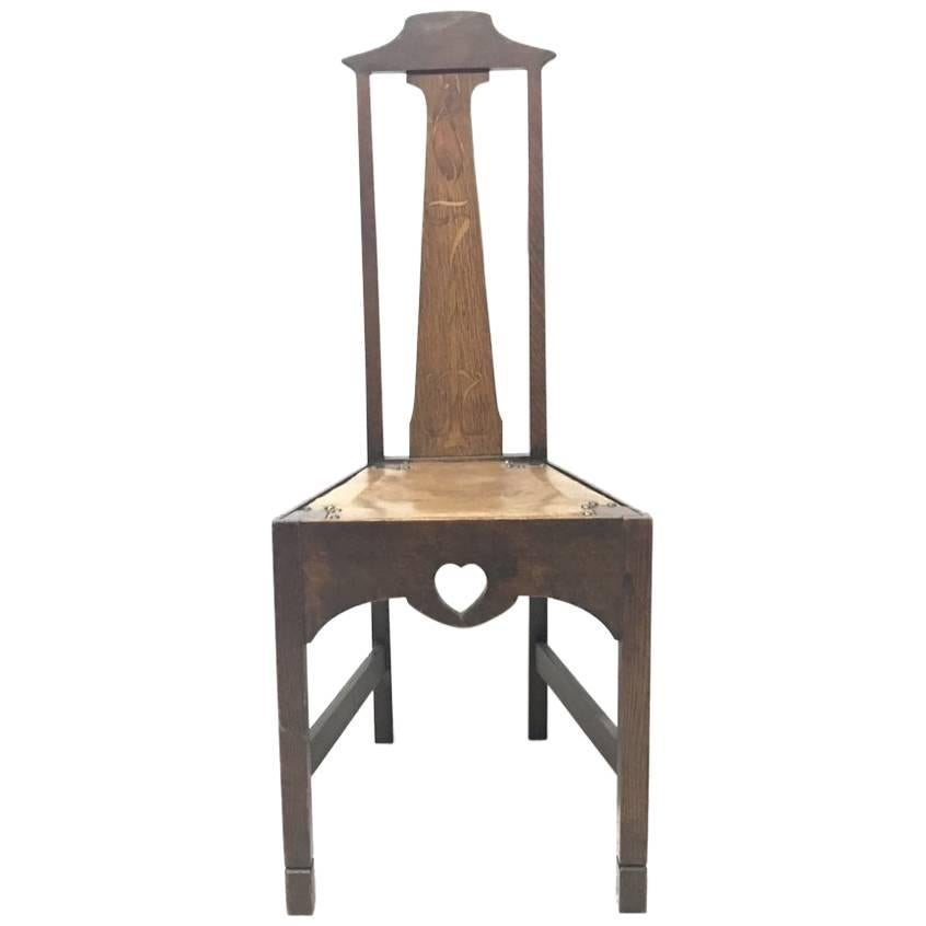 Liberty & Co Attr, an Arts and Crafts Oak Side Chair with Stylised Floral Inlays