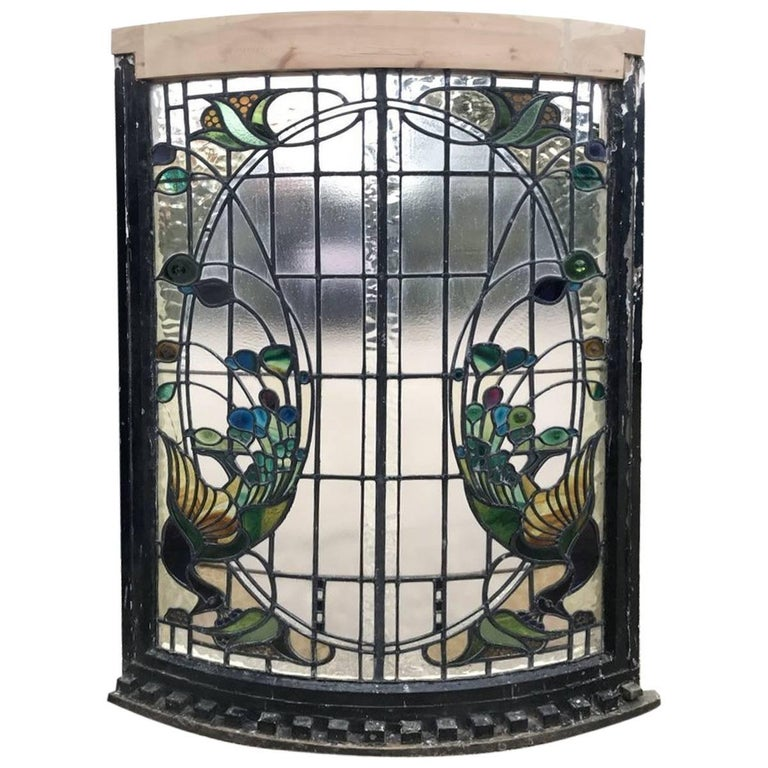 A Rare Arts and Crafts Stained Glass Bow Fronted Window with Colourful Peacocks