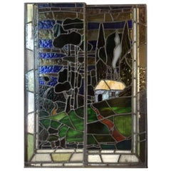 Two Arts & Crafts Stained Glass Windows Depicting a Little Cottage on a Hill