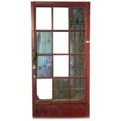 An Arts & Crafts Stained Glass Door with Stylized Floral Details Original Handle