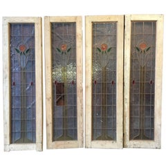 Four Arts & Crafts Stained Glass Doors with Stylized Glasgow Roses Set in Copper