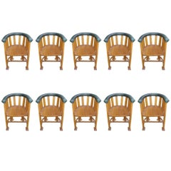 Waring and Gillows, Ten Arts and Crafts Oak Tub Chairs with Shaped Solid Seats