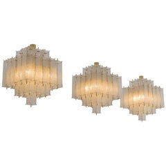Set of Three Layered Brass and Structured Glass Chandeliers