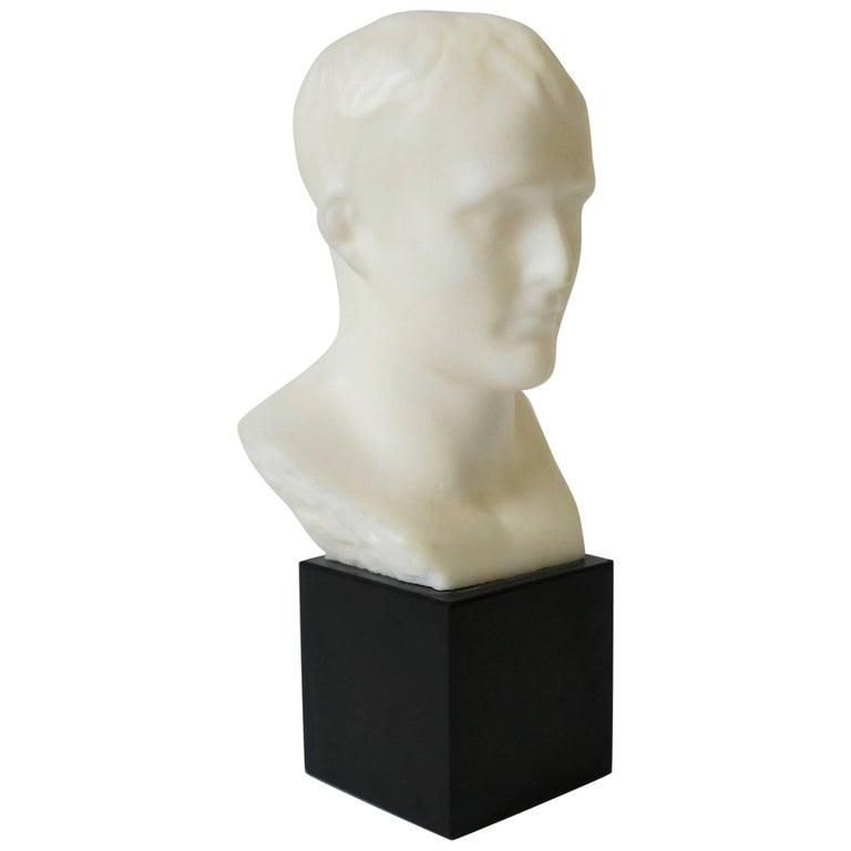 White Male Bust Sculpture on Black Marble Base