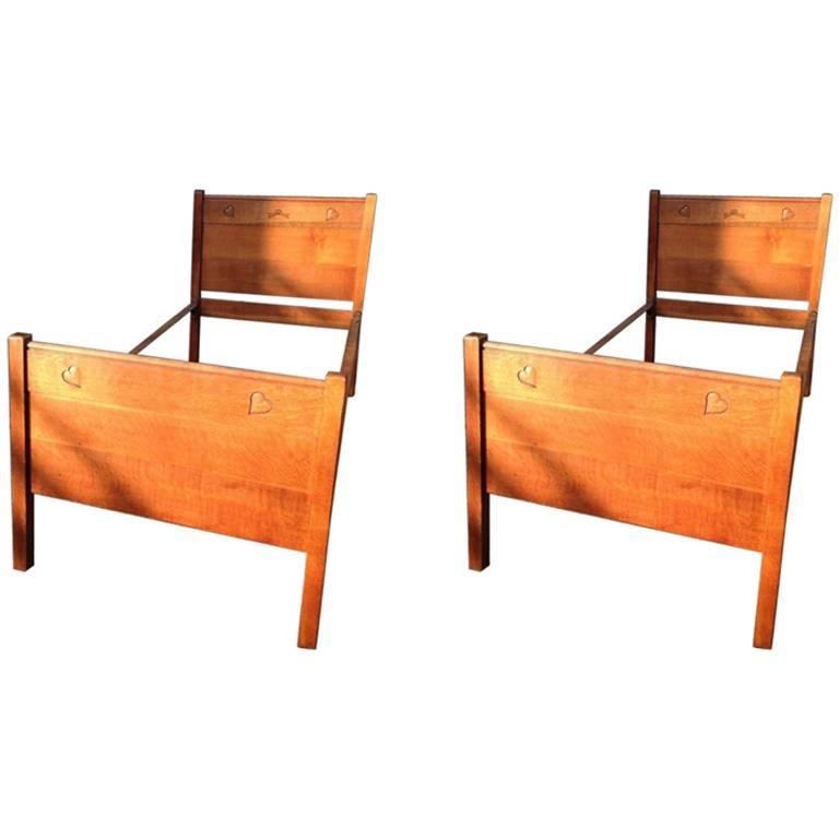 Heals, A Near Pair Of Arts And Crafts Single Oak Beds With