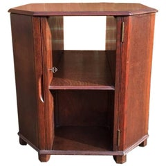 Heals, An Octagonal Oak Cocktail Cabinet with Bottle Storage in the Side Doors