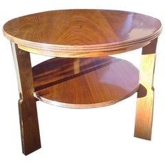 Gordon Russell, a Gunstock Figured Walnut Coffee Table on Gunstock Shaped Legs
