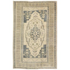 Blue Gray and Cream Mid-20th Century Turkish Oushak Rug with Medallion, Cornices
