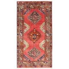 Red Field Vintage Turkish Oushak Rug with Vertical Geometric Medallions