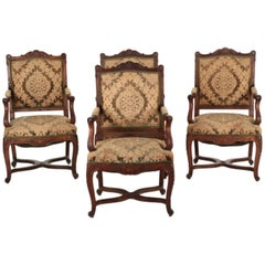 Set of Four Rococo Revival Carved Walnut Armchairs en Cabriolet, 19th Century