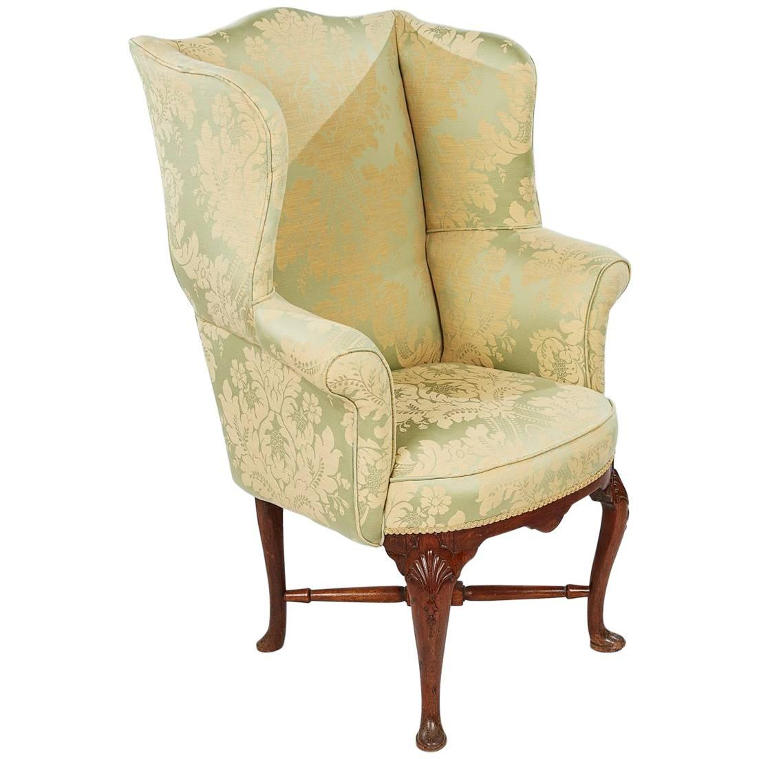 18th century mahogany fully upholstered wing chair