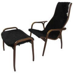 Yngve Ekstrom Lamino Chair and Ottoman by Swedese in Cow Hide