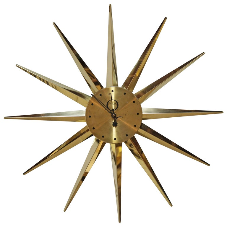 Brass 12 sunburst wall clock in the manner of george for Nelson wall clock