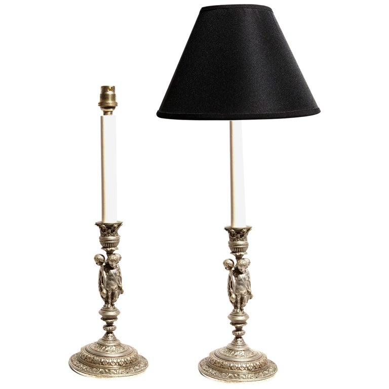 Pair of Renaissance Revival Silvered Candlesticks