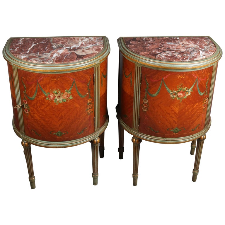 Pair of Adam Style Classical Painted and Gilt Carved Satinwood Demilune Stands